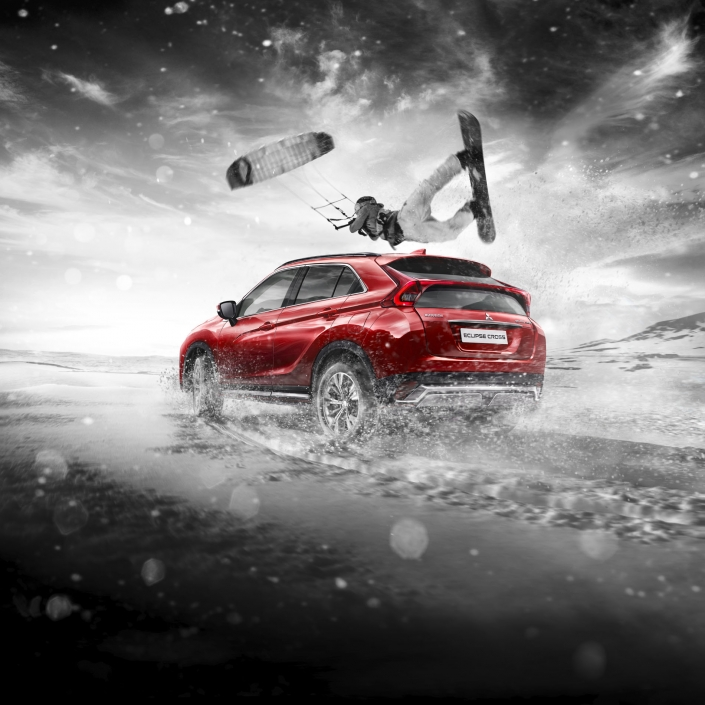 mitsubishi eclipse cross red car driving through snow, kite snowboarder jumping, composing by tobias winkler bildbearbeitung muenchen